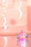 Birthday Princess Crown. Celebration Scene showing little Girl's Princess Crown . Dreamy Pink background and Shiny Reflective Foreground. Sparkles in the royalty free stock photos