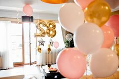 Birthday room with balloons stock photography