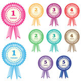 Birthday rosettes for children. From 1 year to 5 years in assorted boy and girl colors. Isolated on white Royalty Free Stock Images