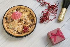 Homemade apple pie with red present and alcohol royalty free stock images
