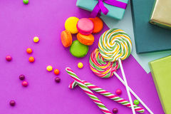 Birthday set uncluding greeting cards, wrapped gifts and sweets on fuchsia background top view Stock Photo