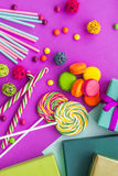 Birthday set uncluding greeting cards, wrapped gifts and sweets on fuchsia background top view Royalty Free Stock Image
