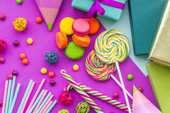 Birthday set uncluding greeting cards, wrapped gifts and sweets on fuchsia background top view Royalty Free Stock Images