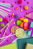 Birthday set uncluding greeting cards, wrapped gifts and sweets on fuchsia background top view Stock Image