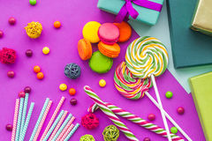 Birthday set uncluding greeting cards, wrapped gifts and sweets on fuchsia background top view Stock Photography