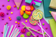 Birthday set uncluding greeting cards, wrapped gifts and sweets on fuchsia background top view Stock Images