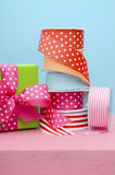 Birthday or special occasion gift wrapping. Birthday or special occasion gift wrapping with bright color gift box and rolls of colorful ribbon Stock Images
