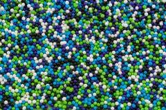 Birthday Sprinkles. Light blue, royal blue, green, and white cake sprinkles Stock Image