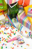 Birthday still life. Champagne with gift boxes, streamers and confetti Royalty Free Stock Images