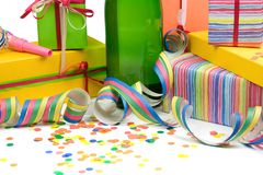 Birthday still life. Champagne with gift boxes, streamers and confetti Stock Image