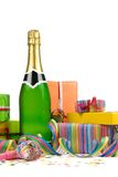 Birthday still life. Champagne with gift boxes, streamers and confetti Stock Photos
