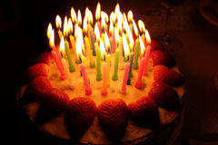 Birthday strawberry cake with lighted candles Royalty Free Stock Images