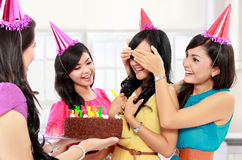 Birthday surprise. Young beautiful women blindfold during surprise birthday party Royalty Free Stock Images