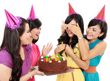 Birthday surprise. Young beautiful women blindfold during surprise birthday party Stock Photos