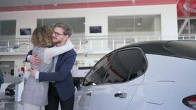 Birthday surprise, husband gives new automobile gift to attractive wife with eyes closed which is emotionally happy at. Birthday surprise, loving husband gives stock footage