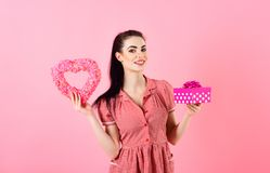 Birthday, surprise, Womans day, shopping, Black Friday concept. Girl with cheerful face, make up and box. Woman smiles and fall in love. Happy girl with Royalty Free Stock Photos