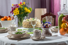 Birthday table ready for acceptance guests. On a bright day Royalty Free Stock Images