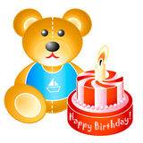 Birthday teddy bear with cake. Teddy bear and birthday cake with flaming candle Royalty Free Stock Photo
