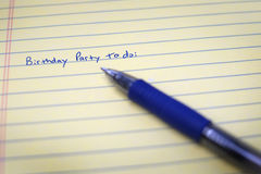 Birthday To Do List on Notebook Paper and Pen Stock Photos