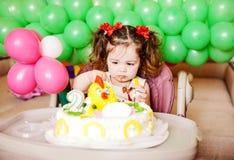 Birthday toddler girl. Cute toddler girl with her birthday cake stock photos