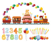 Birthday train. Happy children in a toy train with balloons, birthday cake and gifts Stock Image
