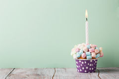 Birthday vanilla cupcake with colorful marshmallows Royalty Free Stock Image