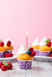 Birthday vanilla cupcakes with fresh raspberries Royalty Free Stock Photography