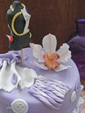 A birthday violet cake fondant with sugar mannequin and sugar orchid close up. A birthday violet cake fondant with sugar mannequin and sugar orchid stock images