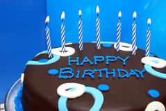 Birthday Wish. A birthday cake waits with its lit candles for that special somebody to make his wish stock photo