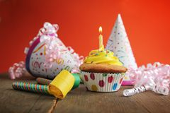Birthday yellow cupcake Stock Photography