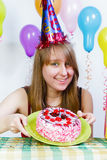 Birthday. A young attractive girl with cake Royalty Free Stock Photo
