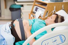 Birthing Mother with Electronic Fetal Monitor on Royalty Free Stock Photos