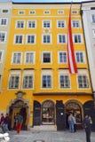Birthplace house by Wofgang Mozart at Getreidegasse 9, Salzburg. Salzburg, Austria - May 23, 2019 : tourists in front of Wofgang Amadeus Mozart`s Birthplace stock photography