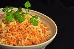 Biryani bowl. Freshly cooked biryani bowl isolated on black background stock photography
