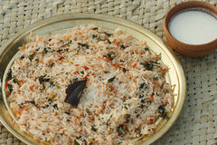 Biryani - An Indian rice dish made with rice, spices and meat/vegetables. Biryani, biriani, or beriani is a set of primarily South Asian rice-based foods made Stock Photography
