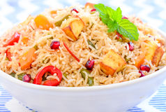 Biryani Rice. A colorful Indian rice dish made from basmati rices, spices, paneer, cubescottage cheese and fresh vegetables Stock Image