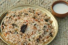 Biryani - um prato indiano do arroz feito com arroz, especiarias e carne/vegetais Fotografia de Stock