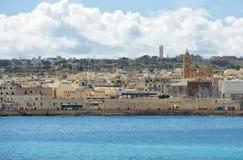 BIRZEBUGGA Malta-mars 12: panoramautsikt av Birzebugga, Malta på marsch 12, 2015, panorama av den Birzebugga byn i Malta på trevl Arkivbild