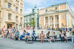 Birzhevaya square. The Chamber of Commerce and Industry of the Russian Federation. People splash in the fountain in hot weather royalty free stock photography