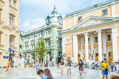 Birzhevaya square. The Chamber of Commerce and Industry of the Russian Federation. People splash in the fountain in hot weather stock images