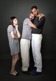 Bisarra glada par med den incredulous flickvännen Fotografering för Bildbyråer
