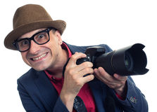 Bisarra paparazzi med den isolerade kameran Royaltyfria Bilder