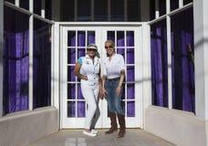 Bisbee, Arizona, USA, April 6, 2015, Phylis Tampio and Leslie Plimpton pose in front of purple draped doorway Royalty Free Stock Image