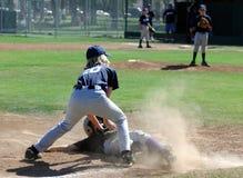 Béisbol - etiqueta en la tercera base Foto de archivo libre de regalías