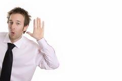 Bisbolhetice de escuta considerável do homem de negócio Fotos de Stock Royalty Free