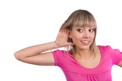Bisbolhetice de escuta da mulher Foto de Stock Royalty Free