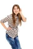 Bisbolhetice de escuta da mulher nova Fotografia de Stock