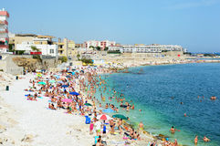 BISCEGLIE, ITALY - AUGUST 3, 2017: Very Crowded Beach Full Of People At The Mediterranean Sea in Apulia turist region, Bisceglie. Italy Stock Photography