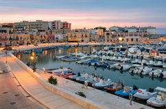 Bisceglie old port at soft sunset light Royalty Free Stock Photo
