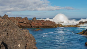 Biscoitos breaking waves in Terceira, wide angle Royalty Free Stock Image